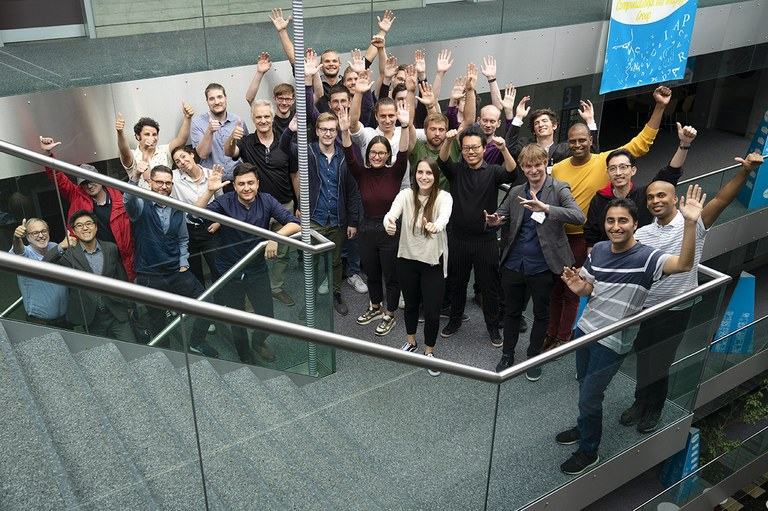 icc2020-group-picture-stairs.jpg